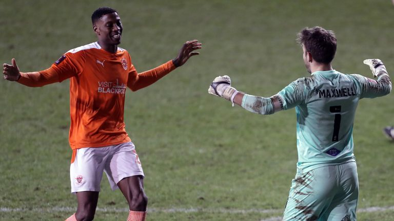 Chris Maxwell (right) was Blackpool's hero after saving from Mathias Pereira in the shoot-out