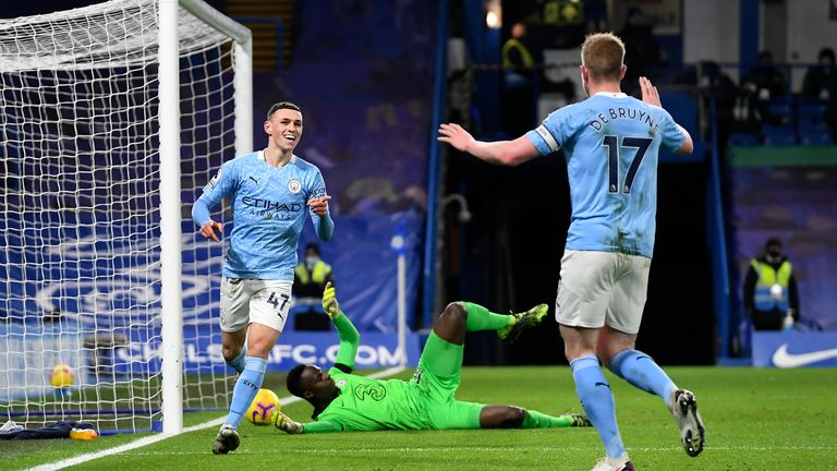 Manchester City...s Phil Foden celebrates with Manchester City...s Kevin De Bruyne after scoring his side...s second goal during the English Premier League soccer match between Chelsea and Manchester City at Stamford Bridge, London, England, Sunday, Jan. 3, 2021. (AP Photo/Ian Walton/Pool)