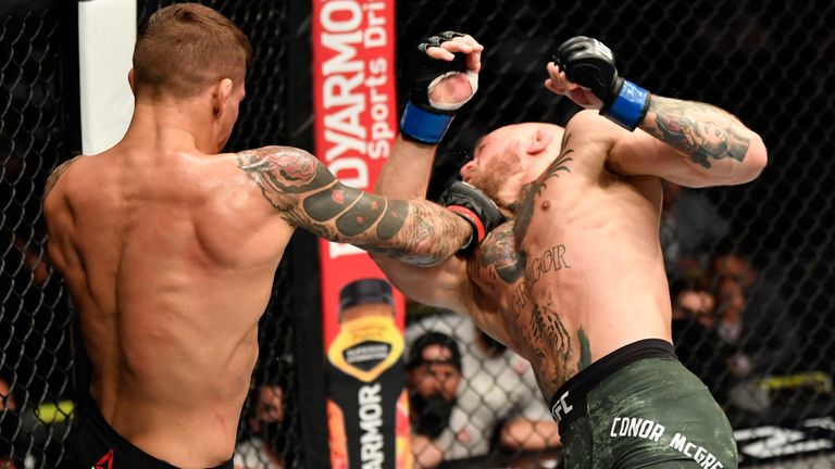 ABU DHABI, UNITED ARAB EMIRATES - JANUARY 23: (L-R) Dustin Poirier punches Conor McGregor of Ireland in a lightweight fight during the UFC 257 event inside Etihad Arena on UFC Fight Island on January 23, 2021 in Abu Dhabi, United Arab Emirates. (Photo by Jeff Bottari/Zuffa LLC)