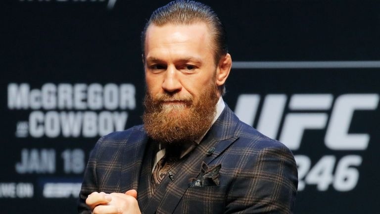 """Conor McGregor motions to the crowd during a news conference for a UFC 246 mixed martial arts bout, Wednesday, Jan. 15, 2020, in Las Vegas. McGregor is scheduled to fight Donald """"Cowboy"""" Cerrone in a welterweight bout Saturday. (AP Photo/John Locher)"""