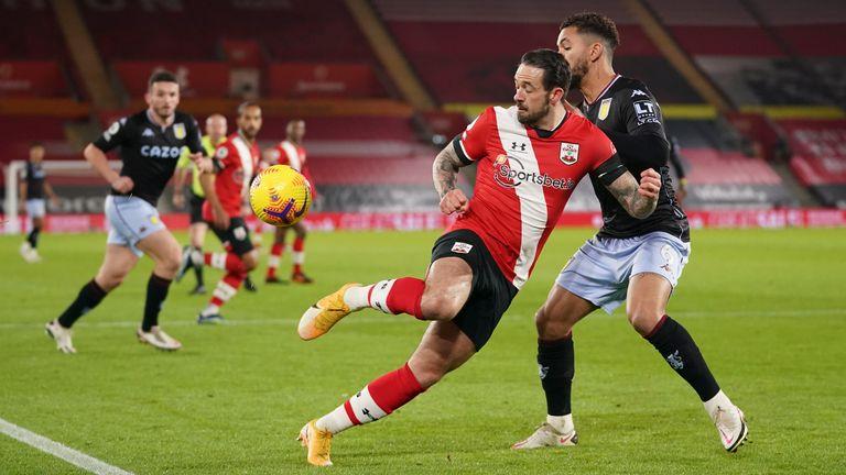 Danny Ings controls the ball under pressure from Douglas Luiz (AP)