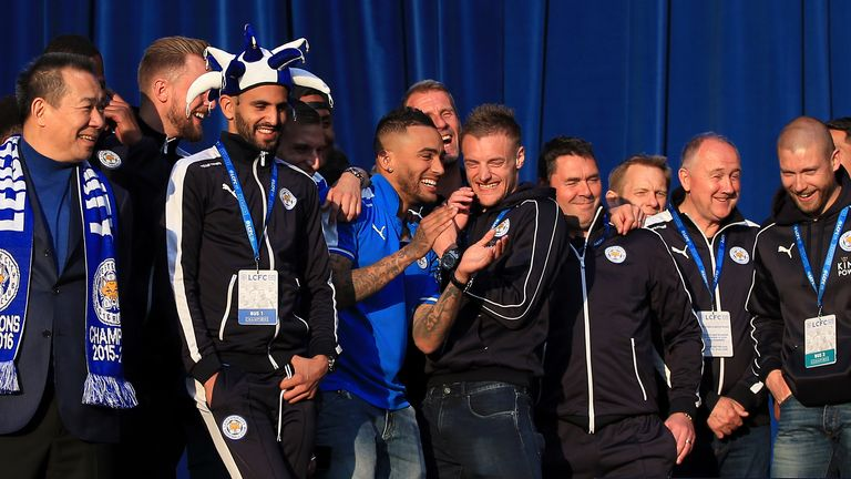 Leicester City's Danny Simpson and Jamie Vardy share a joke on stage as they watch season highlights on a TV alongside their team-mates at Victoria Park during the open top bus parade through Leicester City Centre.