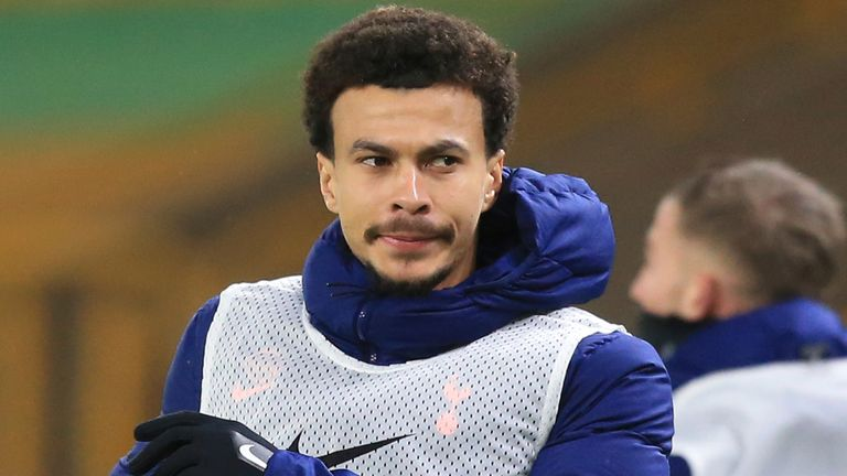 Tottenham's Dele Alli was up along the sidelines as a substitute during the English Premier League soccer match between Wolverhampton Wanderers and Tottenham Hotspur at Molineux Stadium, in Woverhampton, England, Sunday, Dec. 27, 2020. (Lindsey Parnaby / Pool via AP)