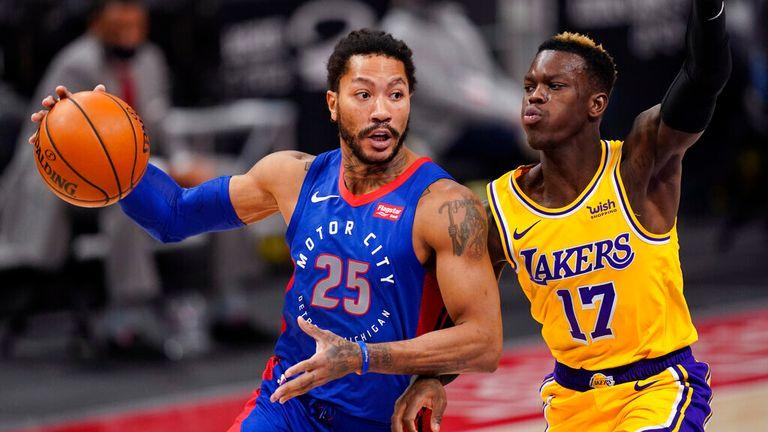 AP - Detroit Pistons guard Derrick Rose (25) looks to pass as Los Angeles Lakers guard Dennis Schroder (17) defends