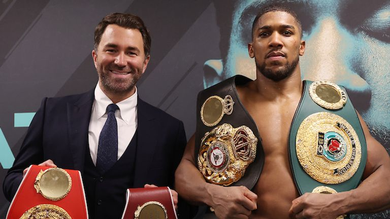 HANDOUT PICTURE COMPLIMENTS OF MATCHROOM BOXING.Anthony Joshua vs Kubrat Pulev, IBF, WBA, WBO & IBO World Title..13 December 2020.Picture By Mark Robinson.Anthony Joshua celebrates with Eddie Hearn in his dressing room.