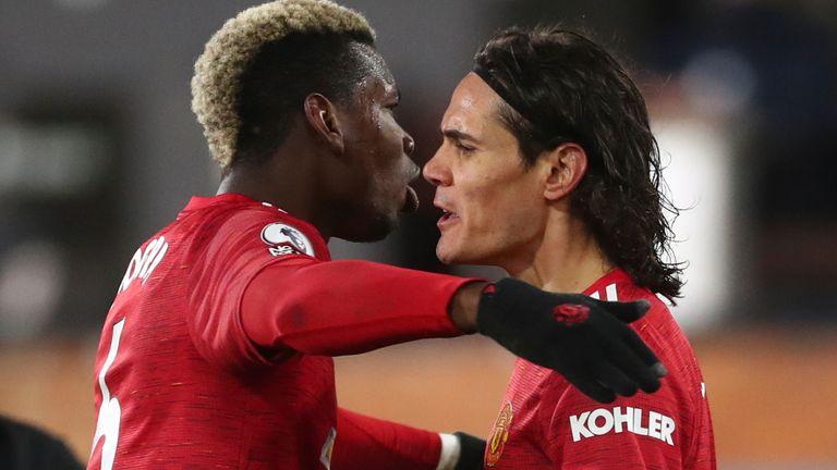 Paul Pogba and Edinson Cavani celebrate the striker's opener for Man Utd