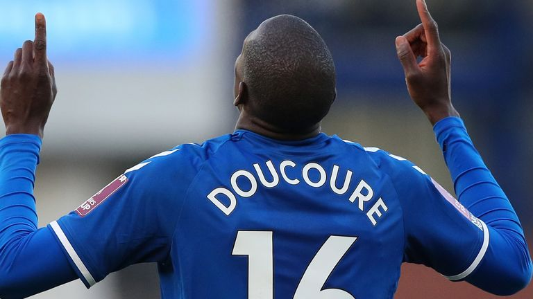 Abdoulaye Doucoure celebrates after scoring in extra-time