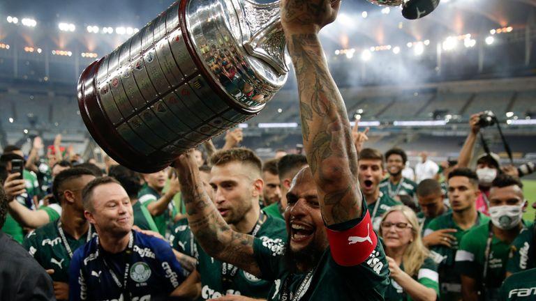 Felipe Melo of Palmeiras celebrates with team mates after winning the Copa Libertadores final