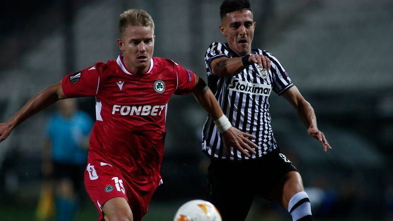 Omonia's Tomas Hubocan, left, and PAOK's Dimitris Giannoulis fight for the ball