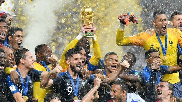 FILE - In this Sunday, July 15, 2018 file photo, France goalkeeper Hugo Lloris lifts the trophy after France won 4-2 during the final match between France and Croatia at the 2018 soccer World Cup in the Luzhniki Stadium in Moscow, Russia. World Cup winner France reclaims the No. 1 spot in the FIFA rankings for the first time in 16 years after defeating Croatia 4-2 for its second World Cup title and jumped up six places. (AP Photo/Martin Meissner, File)