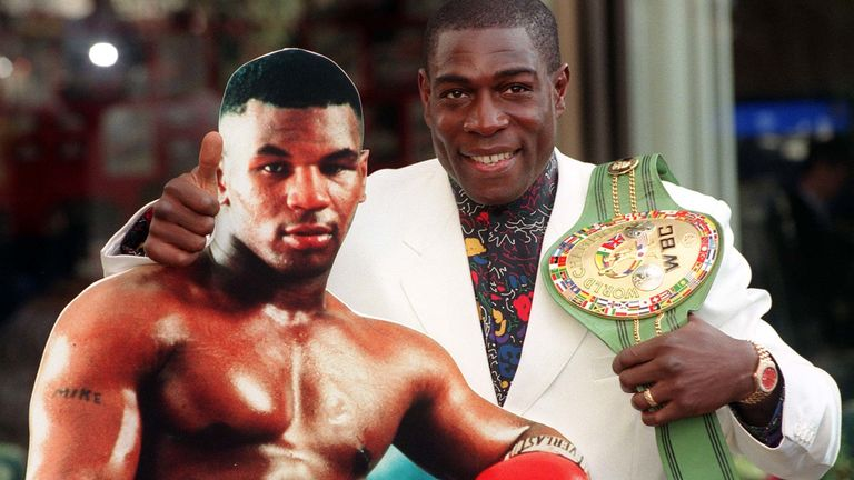 Bruno poses with a cardboard cut-out of Tyson