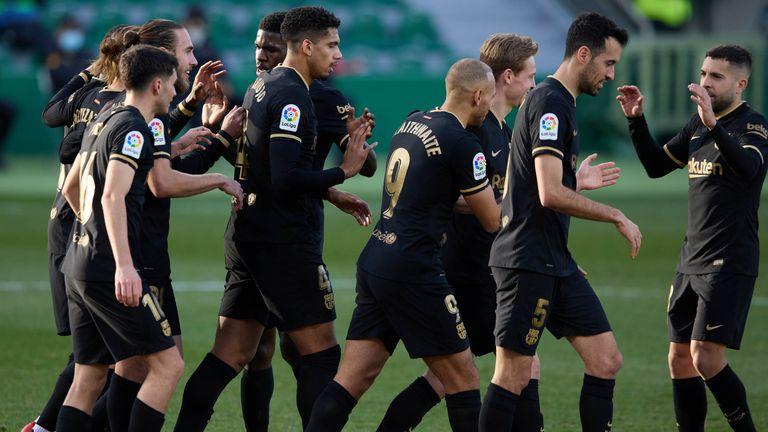 Frenkie de Jong celebrates with team mates