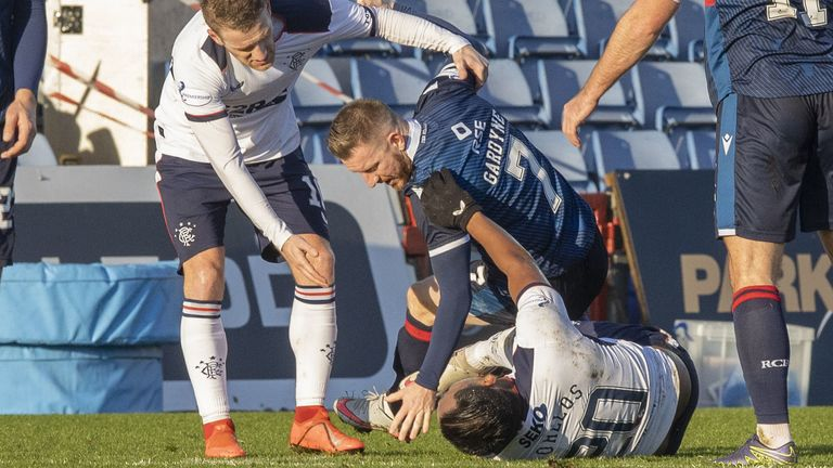 Ross County's Michael Gardyne collides with Rangers' Alfredo Morelos