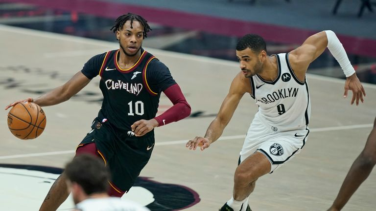 Cleveland Cavaliers' Darius Garland (10) drives past Brooklyn Nets' Timothe Luwawu-Cabarrot (9) in the first half of an NBA basketball game, Friday, Jan. 22, 2021, in Cleveland. (AP Photo/Tony Dejak)