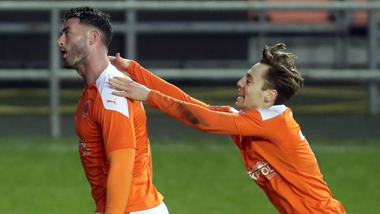 Gary Madine celebrates after giving Blackpool the lead against West Brom