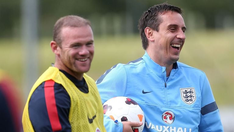 England's Wayne Rooney and assistant coach, Gary Neville (right) during the training session at St George's Park, Burton Upon Trent.