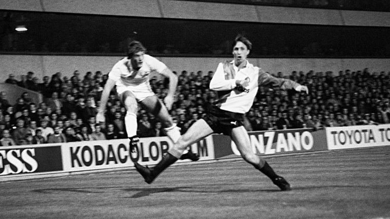 Glenn Hoddle of Tottenham whips in a cross as Feyenoord's Johan Cruyff defends in the 1984 UEFA Cup second-round clash between the sides