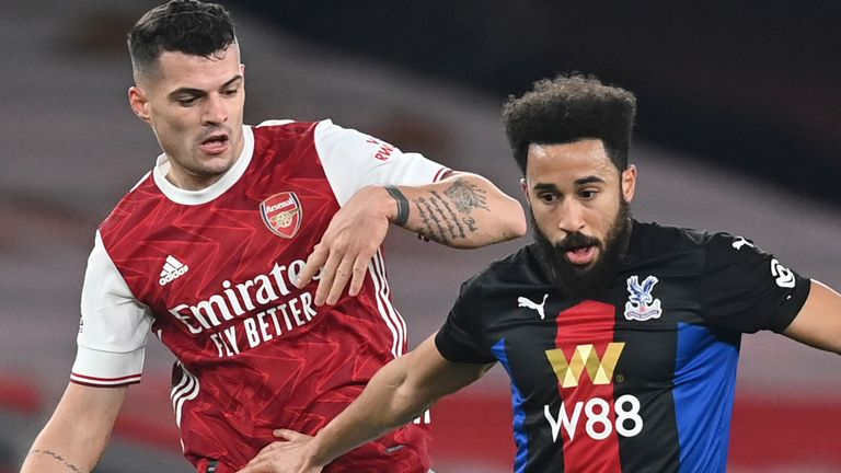 Andros Townsend is marked closely by Arsenal's Granit Xhaka