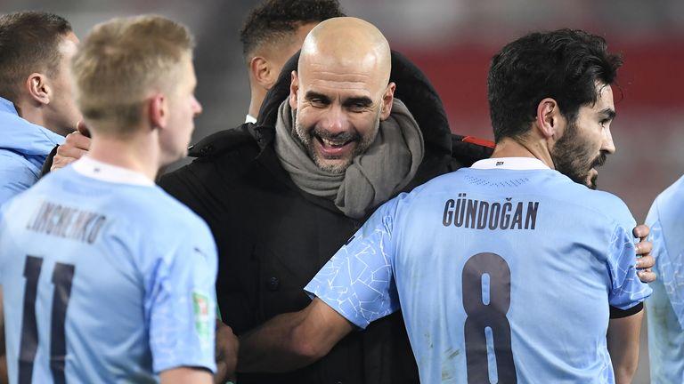 Pep Guardiola celebrates after Man City's win over Man Utd