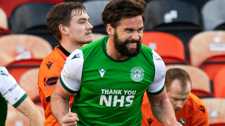 DUNDEE, SCOTLAND - JANUARY 30: Hibernian's Darren McGregor celebrates making it 1-0 during a Scottish Premiership match between Dundee United and Hibernian at Tannadice Park on January 30, 2021, in Dundee, Scotland. (Photo by Ross Parker / SNS Group)