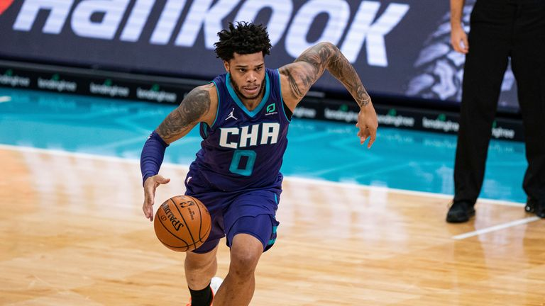 Charlotte Hornets forward Miles Bridges brings the ball up court