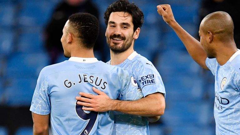 Ilkay Gundogan celebrates with Gabriel Jesus after scoring Man City's second (AP)