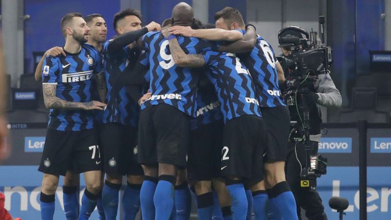 Inter Milan players celebrate after Nicolo Barella scored his side's second goal during a Serie A soccer match between Inter Milan and Juventus at the San Siro stadium in Milan, Italy, Sunday, Jan. 17, 2021. (AP Photo/Luca Bruno)