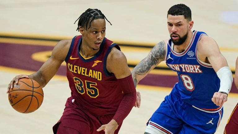 Cleveland Cavaliers' Isaac Okoro (35) drives against New York Knicks' Austin Rivers (8) in the first half of an NBA basketball game