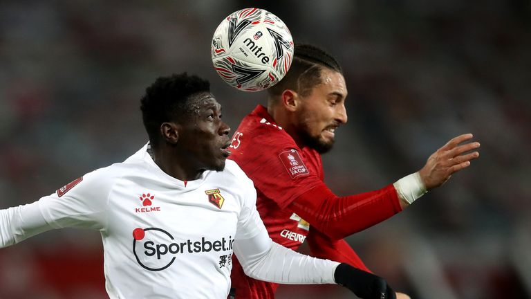 Watford's Ismaila Sarr and Manchester United's Alex Telles battle for the ball