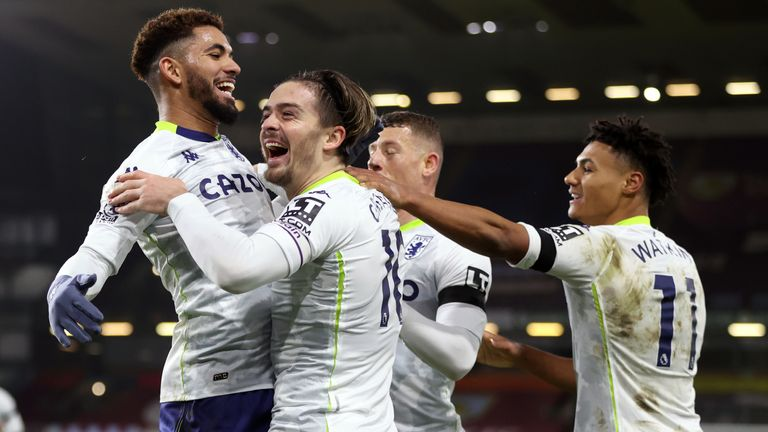 Jack Grealish celebrates with team-mates after scoring Villa's second