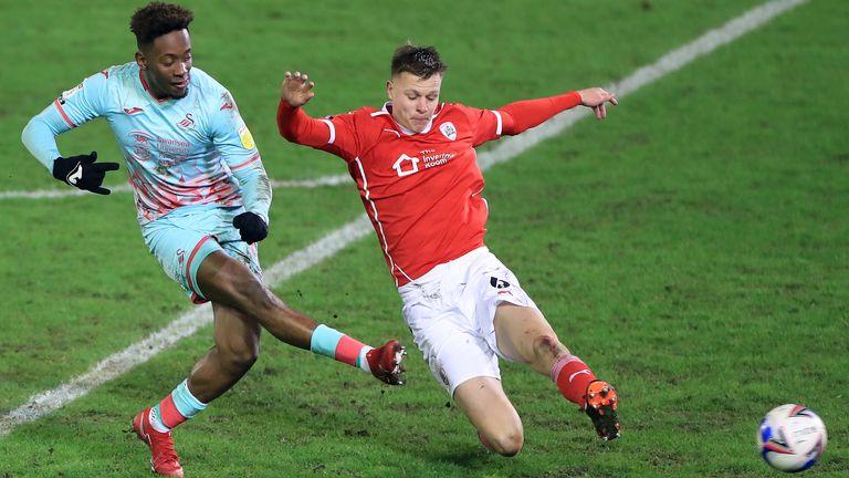 Jamal Lowe scores Swansea's second goal at Barnsley