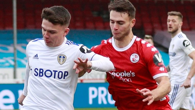 Leeds United's Jamie Shackleton, left, duels for the ball with Crawley Town's Nicholas Tsaroulla - AP photo