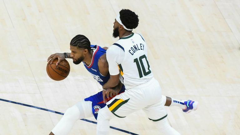 Paul George #13 of the LA Clippers drives around Mike Conley #10 of the Utah Jazz
