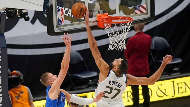 Utah Jazz center Rudy Gobert blocks the shot from Dallas Mavericks forward Kristaps Porzingis