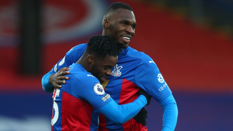 Jeffrey Schlupp (left) celebrates his goal with Christian Benteke
