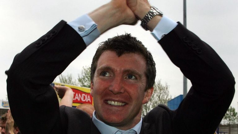 Stockport County's manager Jim Gannon celebrates with fans after avoiding relegation with a draw against Carlisle in the Coca-Cola League Two match at Edgeley Park, Stockport in 2006