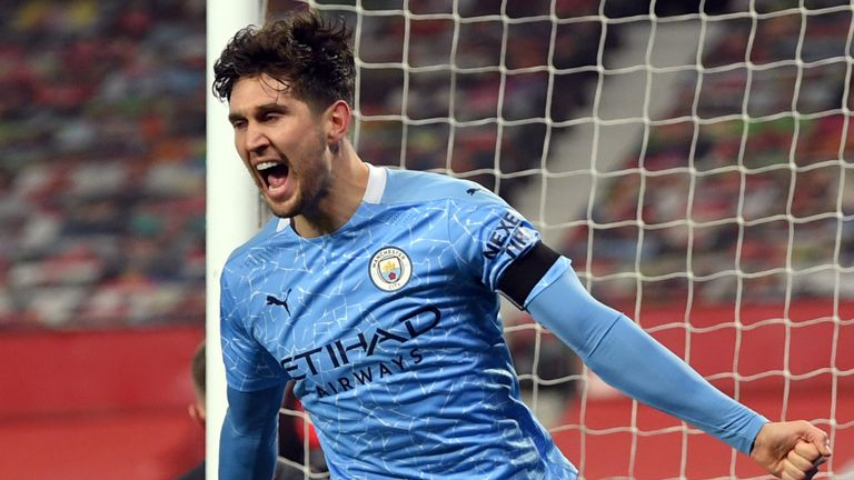 John Stones celebrates after giving Man City the lead at Old Trafford