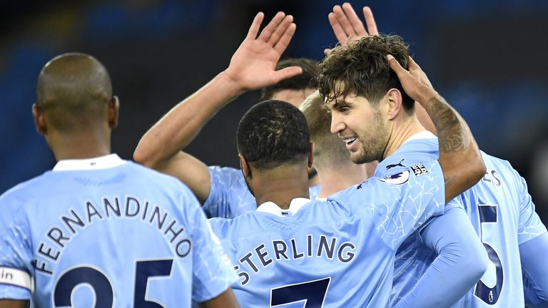 Manchester City's John Stones celebrates scoring his side's third goal of the gam