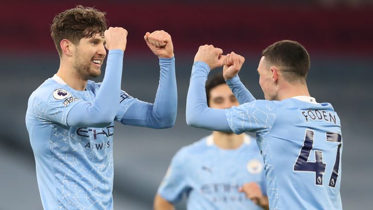 John Stones celebrates scoring Man City's third goal with Phil Foden