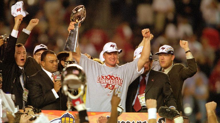 Jon Gruden celebrates wins Super Bowl XXXVII versus the Oakland Raiders in January 2003 (AP Photo/Kevin Reece)