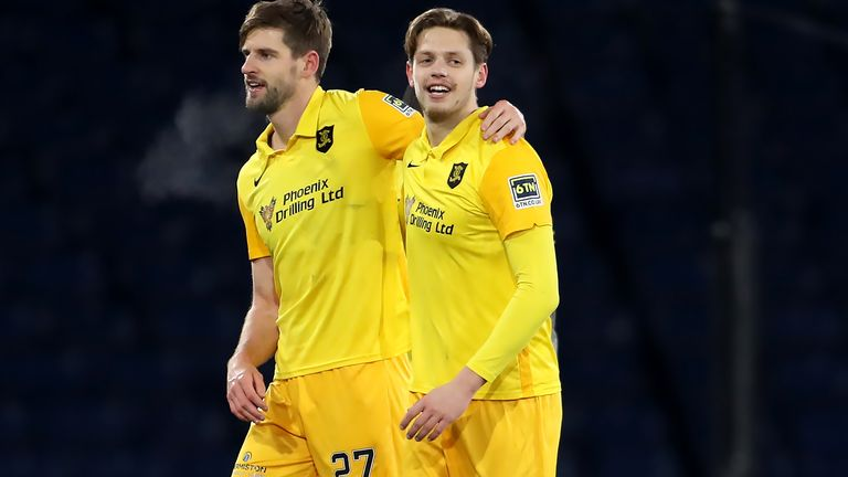 Livingston's Jon Guthrie (left) and Jack Fitzwater celebrate after the Betfred Cup, Semi Final…