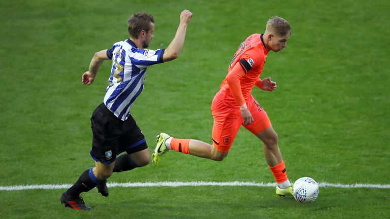 Sheffield Wednesday's Julian Borner and Huddersfield Town's Emile Smith Rowe during the Sky Bet Championship match at Hillsborough, Sheffield.