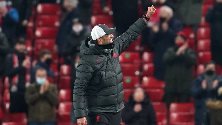 Jurgen Klopp gestures to the fans at Anfield - PA