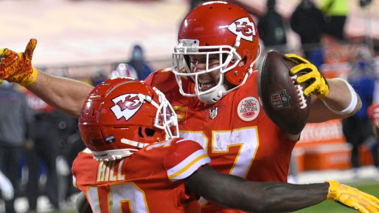 Kansas City tight end Travis Kelce celebrates with teammate Tyreek Hill after catching one of his two touchdown passes