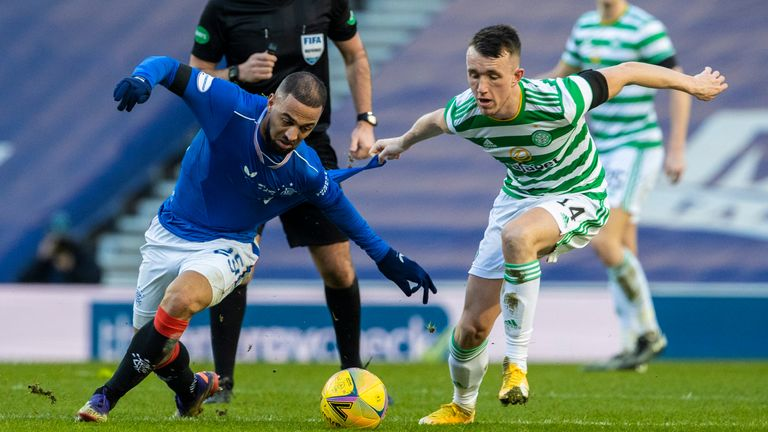 Rangers' Kemar Roofe (left) tussles with Celtic's David Turnbull