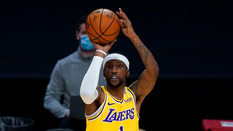 AP - Los Angeles Lakers guard Kentavious Caldwell-Pope (1) takes a shot against the Portland Trail Blazers