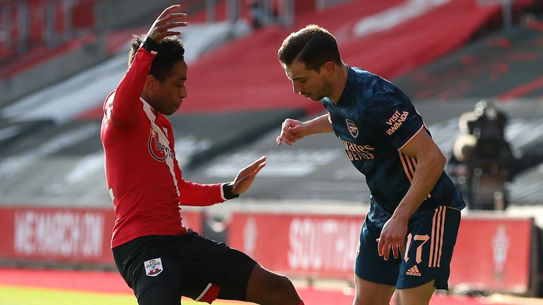 Southampton's Kyle Walker-Peters (left) and Arsenal's Cedric Soares battle for the ball