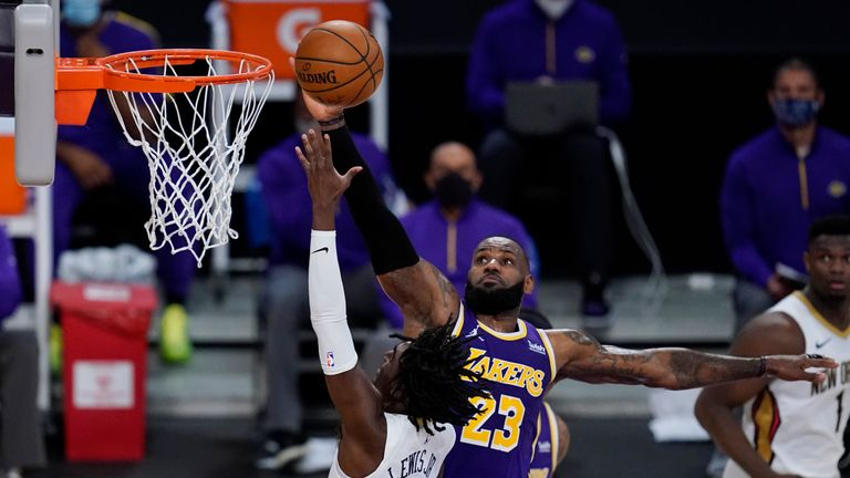 Los Angeles Lakers forward LeBron James (23) defends against New Orleans Pelicans guard Kira Lewis Jr. (13) during the fourth quarter of an NBA basketball game