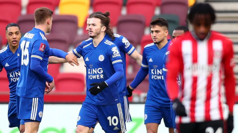 Cengiz Under is congratulated by team-mates after equalising for Leicester