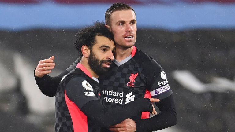 Mohamed Salah is congratulated by Jordan Henderson after his second strike